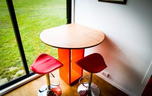 dining area red stools beech table