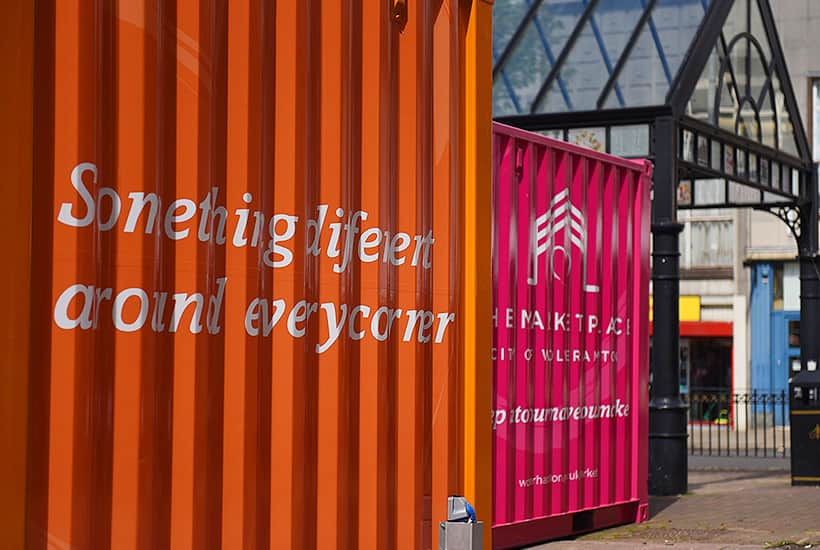 converted shipping container market stall open for business