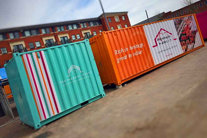multicoloured market stall converted shipping containers