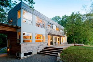 exterior cedar clad modern shipping container home lake iosco 2