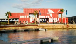 experiential shipping containers stacked quayside