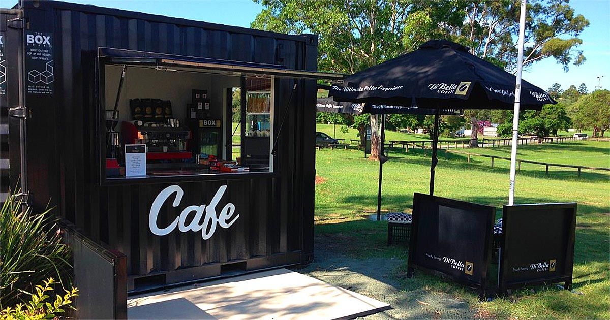 black shipping container pop up cafe