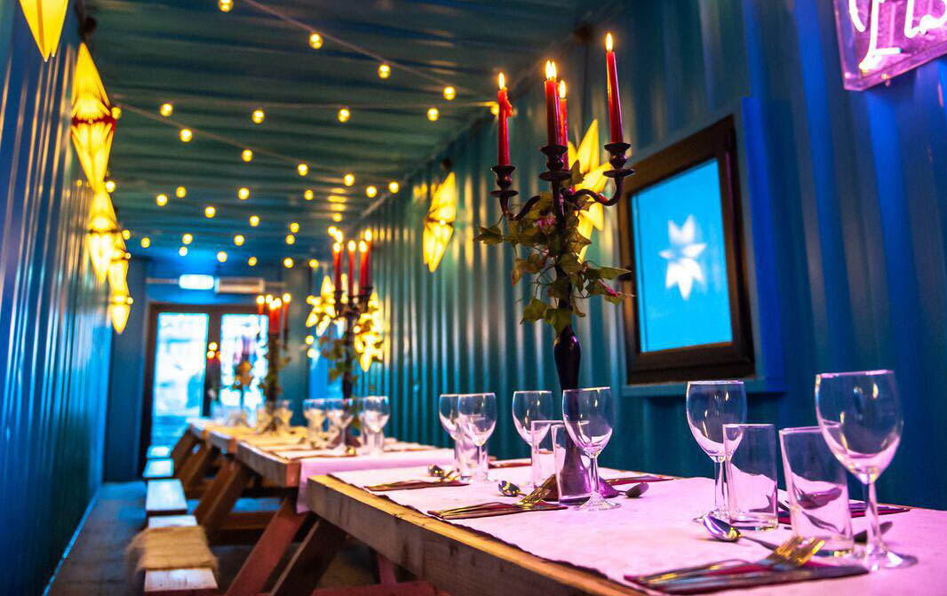 shipping container-cafe dining table fairy lights